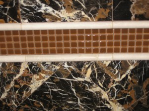 Marble tile and Glass Mosaic creates a detail that stands out